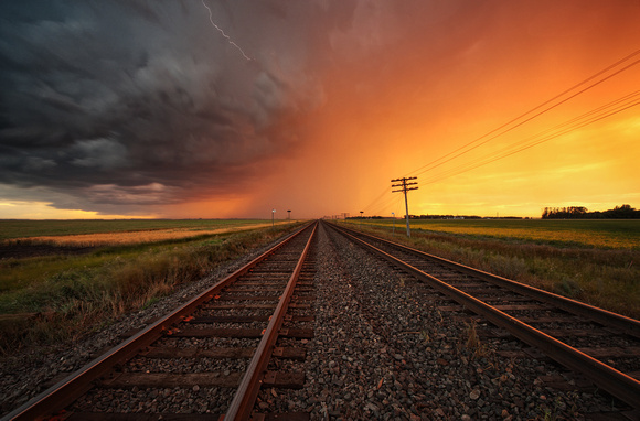 Sunset Storm Over The Railroad Tracks